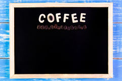 Wooden english alphabet coffee and coffee bean on the blackboard.  Royalty Free Stock Photo