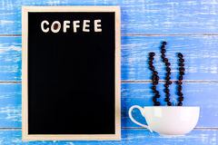 Wooden english alphabet coffee and coffee cup on the blackboard. Wooden english alphabet coffee and coffee cup on the blackboard Royalty Free Stock Photography