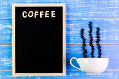 Wooden english alphabet coffee and coffee cup on the blackboard. Wooden english alphabet coffee and coffee cup on the blackboard Royalty Free Stock Images