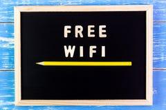 Wooden english alphabet free wifi on the blackboard. Stock Photography