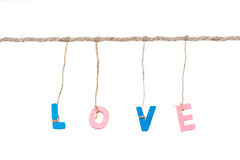 Wooden english alphabet love word binded by rope Royalty Free Stock Image