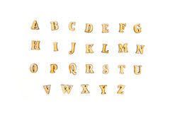 Wooden English alphabet on white Stock Images