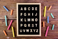 Wooden english alphabet A-Z on the blackboard.chalk on wooden ta. Ble Royalty Free Stock Photos