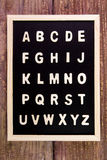 Wooden english alphabet A-Z on the blackboard.on wooden table. Stock Photo