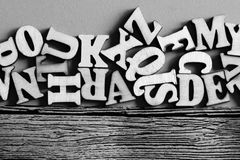 Wooden English letters in bulk and on wooden blue background. Education stock photography