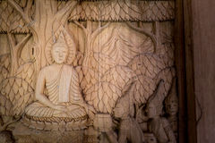 Wooden engraving of Buddha's biography. On the door Royalty Free Stock Images