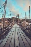 Wooden entrance bridge to the island of Koh Stock Image