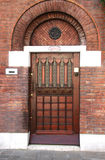 Wooden  entrance door with three door-locks Royalty Free Stock Photography