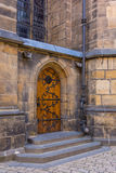 Wooden entrance door to the medieval temple, St. Vitus Cathedral, Prague, Czech Republic Royalty Free Stock Image