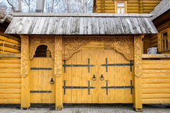 Wooden entrance gate. Carved gate decoration, ornamental patterns on old house, Gorodets, Russia Stock Images
