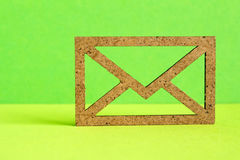 Wooden envelope icon on green background.  Royalty Free Stock Images