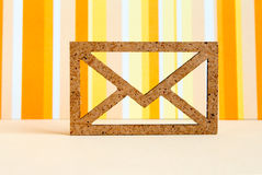 Wooden envelope icon on orange striped background Royalty Free Stock Images