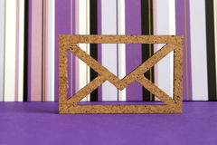 Wooden envelope icon on purple striped background Royalty Free Stock Images