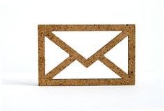 Wooden envelope icon on white background.  Stock Photo