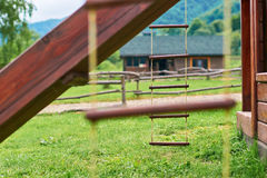 Wooden equipment on kinds playground Royalty Free Stock Photo