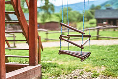 Wooden equipment on kinds playground Stock Photos