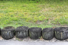 Wooden Erosion Control Logs Outside. Wooden tree logs partly buried in the ground together as a wall to help prevent soil erosion. Part of a soil erosion barrier royalty free stock photography
