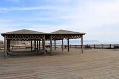 Wooden esplanade with gazebo stock photos