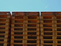 Wooden euro pallets stocked outside at transportation company, stored pallets. New wooden euro pallets stocked outside at transportation company, stored pallets Royalty Free Stock Photo