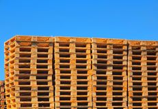 Wooden euro pallets stocked outside at transportation company, stored pallets. New wooden euro pallets stocked outside at transportation company, stored pallets Stock Photo
