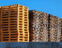 Wooden euro pallets stocked outside at transportation company, stored pallets. New wooden euro pallets stocked outside at transportation company, stored pallets Royalty Free Stock Photography