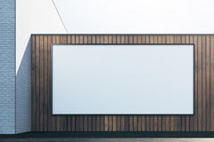 Wooden exterior with white frame front. Front view of abstract brick wooden exterior with empty white frame. Advert, commerce, retail and signboard concept. Mock Royalty Free Stock Photos