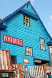 Wooden facade of a colorful blue Post Office Stock Photography