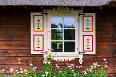 Wooden facade with a retro (vintage) painted shutters. Window of the old house Stock Photography