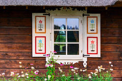 Wooden facade with a retro vintage painted shutters. Window of the old house. Lithuania Royalty Free Stock Photography