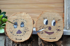 Wooden faces. Sided wooden trunks broken and drawn with him and embarrassed her cute cute Stock Images
