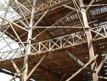 Wooden Factory. Rubber Air-Drying Building made of many strips of wood under construction at  Palembang, Indonesia. This building will be used to hang thousands Stock Photo