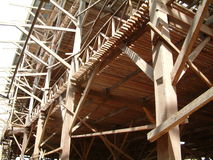 Wooden Factory. Rubber Air-Drying Building made of many strips of wood under construction at Palembang, Indonesia. This building will be used to hang thousands Stock Image