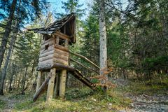 Wooden fairytale treehouse, playing house on children playground Royalty Free Stock Photos