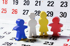 Wooden Family Figures on Calendar Page Stock Image