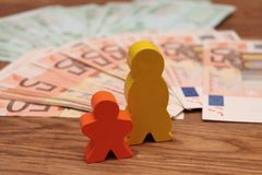 Wooden family with money stock image