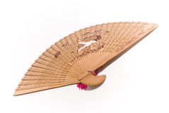 Wooden fan. With oriental pattern on the white background royalty free stock photos