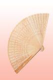 Wooden fan. Handmade wooden fan on pink background Royalty Free Stock Photos