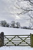 Wooden farm gate in winter Royalty Free Stock Image