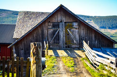 Wooden farm house in morning sun Royalty Free Stock Image