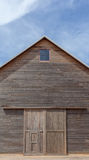A wooden farm shed and blue sky Stock Photography