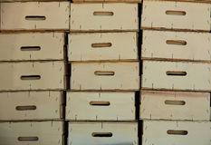 Wooden farmer harvest boxes stacked in rows Royalty Free Stock Photos
