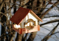 Wooden feeder for birds in winter Stock Photo