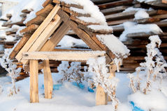 Wooden feeder for birds in winter snow Stock Image