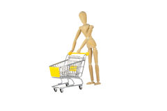 Wooden female doll in shopping madness Royalty Free Stock Photo