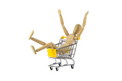 Wooden female doll in shopping madness Stock Photo