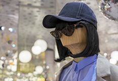 Wooden female mannequin in a cap and sunglasses.  royalty free stock photos