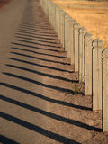 Wooden fence. At sunset Stock Image