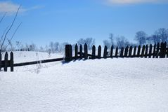 Wooden fence. Covered with snow Royalty Free Stock Photos