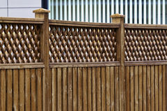 A wooden fence. A shot of the side of a wooden fence stock images
