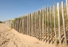 Wooden Fence. On the beach at Noordwijk, Holland royalty free stock image